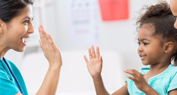 caregiver giving patient high five